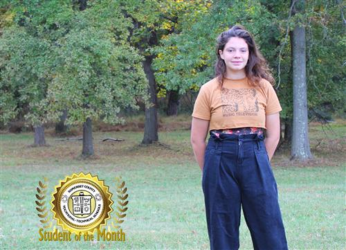 Jenna Shallop, SCVTHS student of the month for October 2019 stands on the campus in front of trees.
