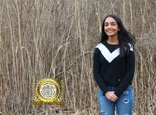 Parthavi Patel, SCVTHS Student of the Month for January 2020, poses in front of a wooded area on campus