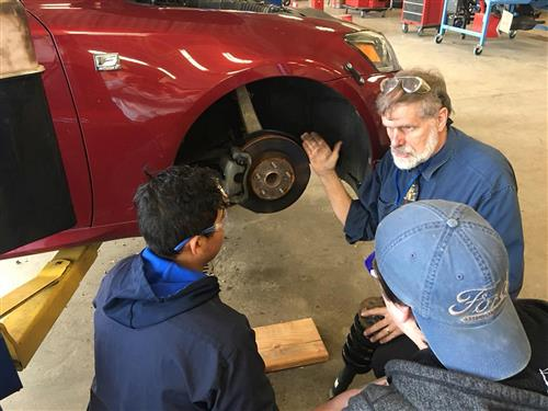 Automotive-Diesel instructor lecturing students on repair techniques