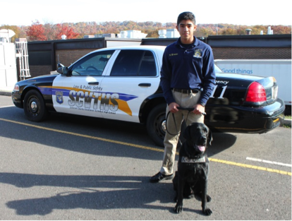 Law and Public Safety student with a law enforcement dog