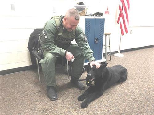 Officer and black German shepherd dog from Somerset County's K9 unit
