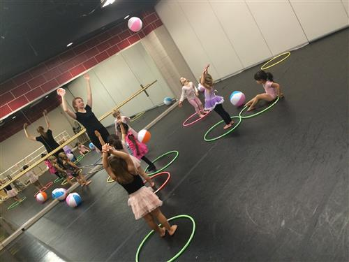 Students and instructor, in the Little Steps Dance Prorgram using hula hoops in class