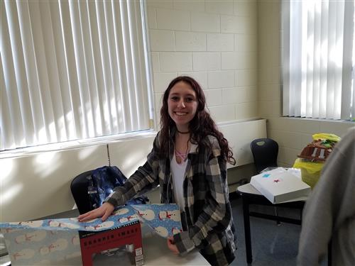 TOPS STUDENTS BRING HOLIDAY CHEER TO AGAPE HOUSE CHILDREN