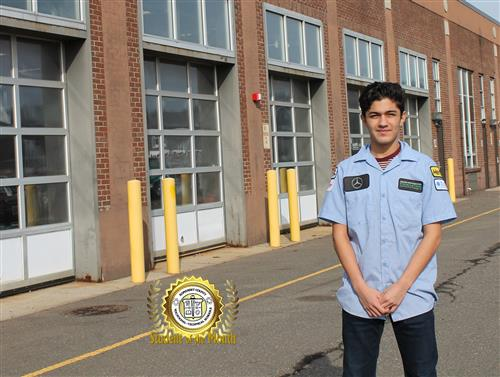 Auto Body student of the Month Christian Martinez standing near his shop on the campus of SCVTHS