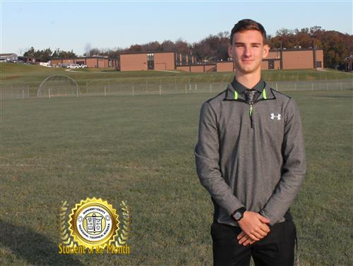 Edward Cunningham stands in a field on the campus of SCVTHS after being named Student of the Month