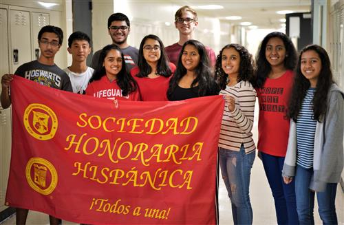 SCVTHS students holding banner after winning medals for excelling in the National Spanish Examinations