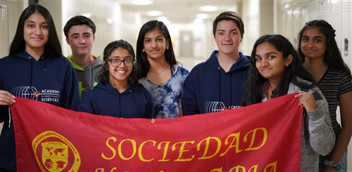SCVTHS students holding banner after excelling in the National Spanish Examinations.