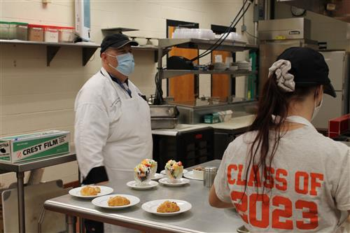 SCVTHS Culinary Arts Instructor Keith Johnson directs students in the kitchen, while preparing for the event.