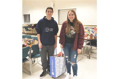 Christopher Masiello is pictured with his sister Michelle at a food collection site.