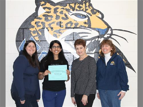 SCVTHS student Veda Kota holds certificate she won for 1st place in the Rutgers Oncology Olympiad
