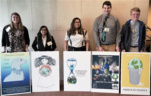 Students pose with their posters at United Nations Conference