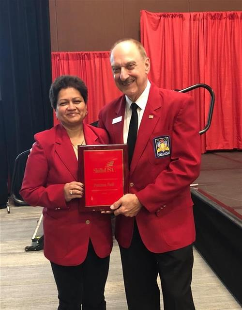 Pratima Patil receives SkillsUSA's Outstanding Career and Technical Educator award from SkillsUSA E
